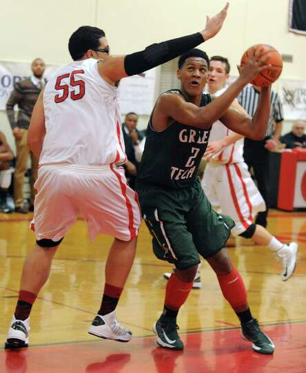 Green Tech's Desonte Welch drives to the basket against Albany Academy's Marcus Jacksonduring a bask