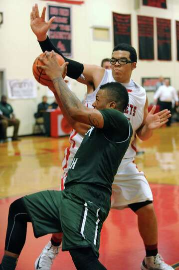 Green Tech's Kristopher Clark drives to the basket against Albany Academy's Marcus Jackson during a