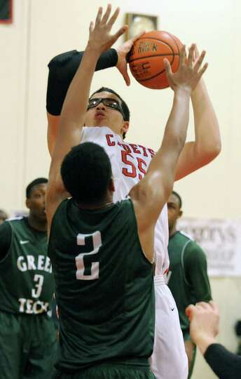 Albany Academy's Marcus Jackson drives and makes a basket against Green Tech's Desonte Welch during