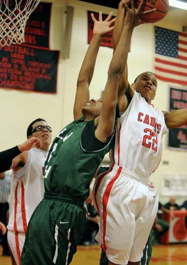 Green Tech's Musziel Jones goes up for a rebound against Albany Academy's Ray Jerome during a basket