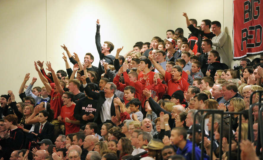 Albany Academy's fans cheer during a basketball game against Green Tech on Monday Feb. 11, 2013 in A