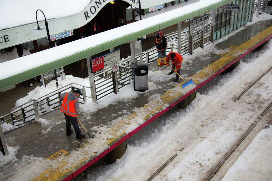 Long Island Rail Road station employees remove ice and snow from a platform in Ronkonkoma, N.Y., Feb. 11, 2013. As the New York City region started a new workweek on Monday, some commuters, especially in Connecticut and on eastern Long Island, still had to cope with the aftermath of Friday's mammoth snowstorm. (Uli Seit/The New York Times) Photo: ULI SEIT / NYTNS