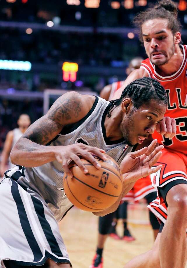 The Spurs' Kawhi Leonard looks for room around the Bulls' Joakim Noah during second half action Monday Feb. 11, 2013 at the United Center in Chicago. The Spurs won 103-89. Photo: Edward A. Ornelas, San Antonio Express-News / © 2013 San Antonio Express-News