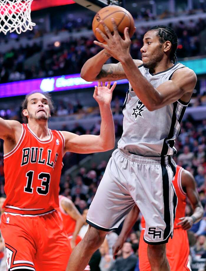 The Spurs' Kawhi Leonard looks to pass around the Bulls' Joakim Noah during second half action Monday Feb. 11, 2013 at the United Center in Chicago. The Spurs won 103-89. Photo: Edward A. Ornelas, San Antonio Express-News / © 2013 San Antonio Express-News