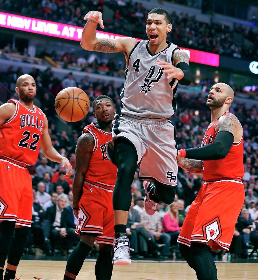 The Spurs' Danny Green (center) reacts after being fouled by Chicago Bulls' Nate Robinson (center left) as Chicago Bulls' Taj Gibson (left) and Chicago Bulls' Carlos Boozer look on during first half action Monday Feb. 11, 2013 at the United Center in Chicago. Photo: Edward A. Ornelas, San Antonio Express-News / © 2013 San Antonio Express-News