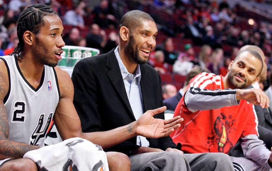 The Spurs' Kawhi Leonard (from left), Tim Duncan, and Tony Parker joke while on the bench during second half action against the Chicago Bulls Monday Feb. 11, 2013 at the United Center in Chicago. The Spurs won 103-89. Photo: Edward A. Ornelas, San Antonio Express-News / © 2013 San Antonio Express-News