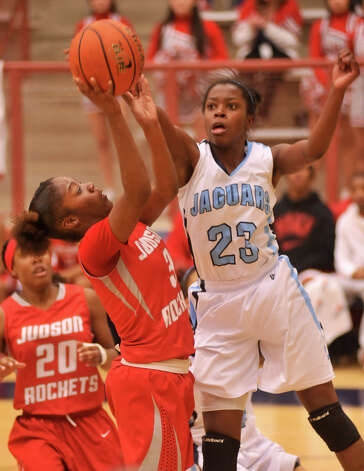 Johnson's Erica Sanders (23) blocks a shot by Judson's LaQueisha Brown during their District 5A game Monday night. Photo: Robin Jerstad, Robin Jerstad / For The Express-News
