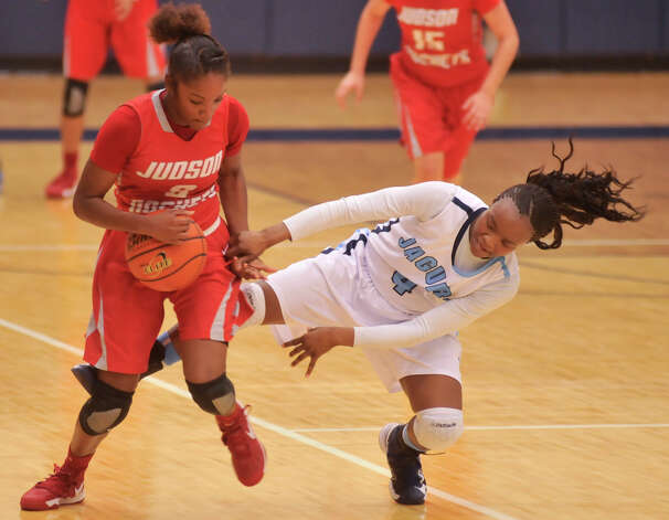 Judson's LaQueisha Brown (3) steals the ball from Johnson's Gabbie Bowie (4) during their District 5A game Monday night. Photo: Robin Jerstad, Robin Jerstad / For The Express-News