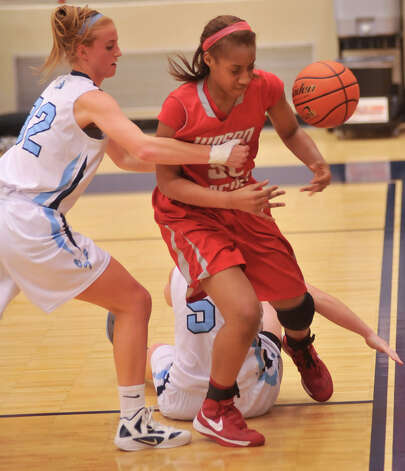 Johnson's Morgan Stearns (left) battles Judson's Simone Fields for a rebound during their District 5A game Monday night. Johnson's Brie Foresman is on the floor. Photo: Robin Jerstad, Robin Jerstad / For The Express-News