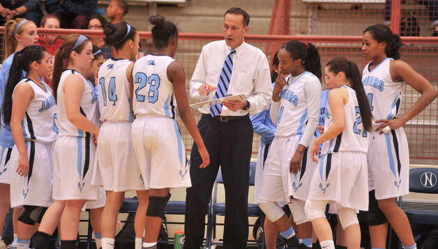 Johnson Coach Randal Evans gives instructions to his players during a timeout of their District 5A games versus Judson Monday night. Photo: Robin Jerstad, Robin Jerstad / For The Express-News