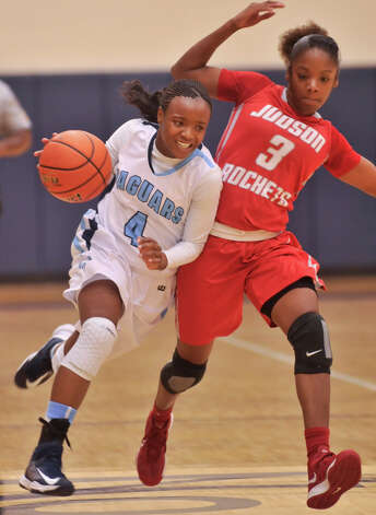 Johnson's Gabbi Bowie (4) tries to drive past Judson's LaQueisha Brown during their District 5A game Monday night. Photo: Robin Jerstad, Robin Jerstad / For The Express-News