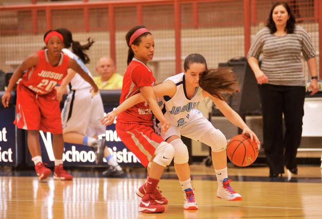 Johnson's Amy Jungbluth tries to dribble around the full-court pressure of Judson's Samantha  Allen during their Class 5A District game Monday night. Photo: Robin Jerstad, Robin Jerstad / For The Express-News