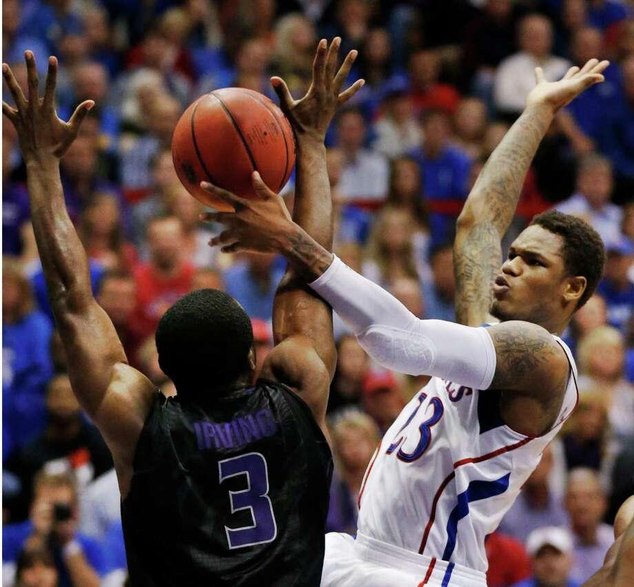 Kansas' Ben McLemore fights Kansas State's Martavious Irving (3) for a rebound Monday night. Photo: Orlin Wagner, STF / AP