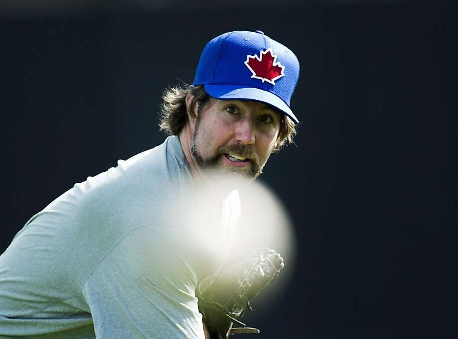 Toronto Blue Jays starting pitcher R.A. Dickey pitches as he warms up during baseball spring training in Dunedin, Fla., Monday, Feb. 11, 2013. (AP Photo/The Canadian Press, Nathan Denette) Photo: Nathan Denette, Associated Press