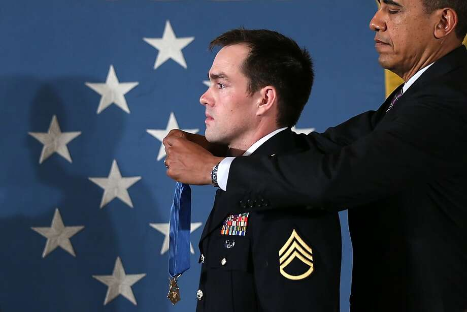 WASHINGTON, DC - FEBRUARY 11:  U.S. President Barack Obama (R) presents the Medal of Honor for conspicuous gallantry to Clinton Romesha, a former active duty Army Staff Sergeant, at the White House February 11, 2013 in Washington, DC. Romesha received the Medal of Honor for actions during combat operations against an armed enemy at Combat Outpost Keating, Kamdesh District, Nuristan Province, Afghanistan on October 3, 2009.  (Photo by Alex Wong/Getty Images) Photo: Alex Wong, Getty Images