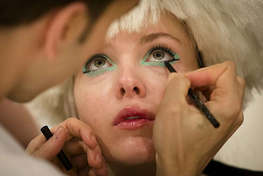 A model is prepared backstage before the Betsey Johnson Fall 2013 collection is shown during Fashion Week in New York, Monday, Feb. 11, 2013. (AP Photo/John Minchillo) Photo: John Minchillo, Associated Press