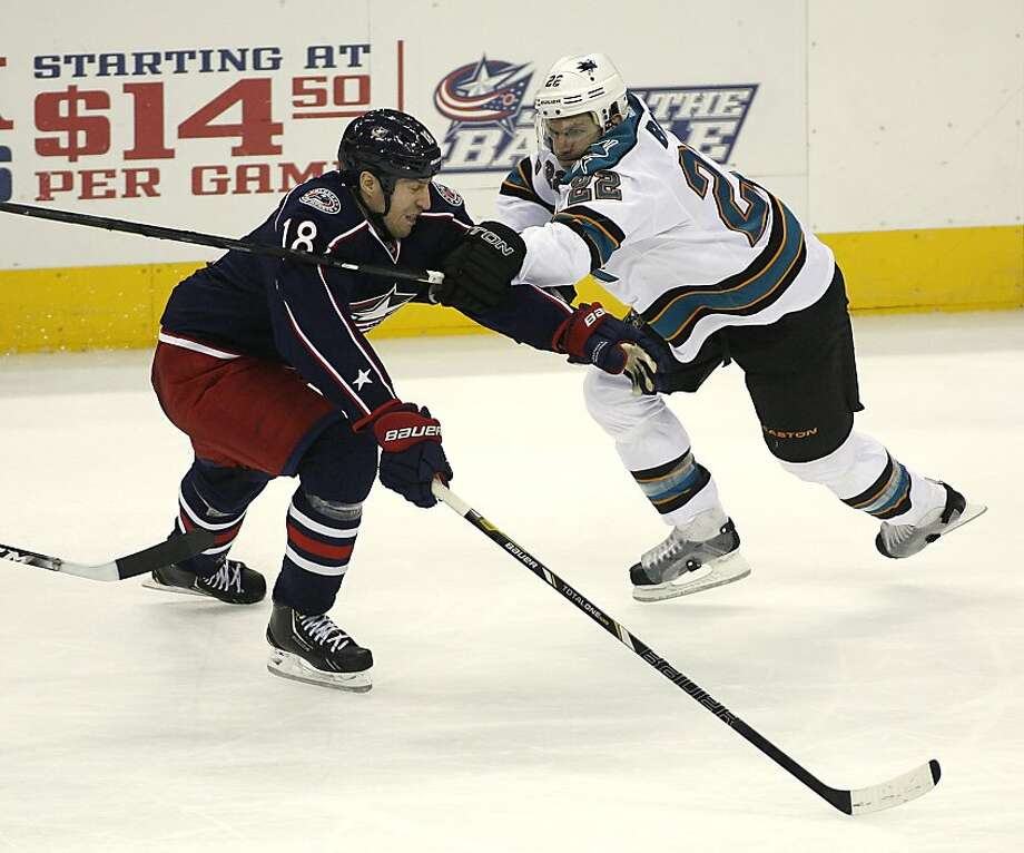 Columbus Blue Jackets' R.J. Umberger (18) collides with San Jose Sharks' Dan Boyle (22) during the third period of an NHL hockey game, Monday, Feb. 11, 2013, in Columbus, Ohio. Columbus won 6-2. (AP Photo/Mike Munden) Photo: Mike Munden, Associated Press