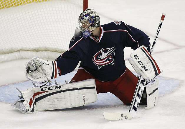 Columbus Blue Jackets  goalie Steve Mason (1) gloves a shot by the San Jose Sharks during the third period of an NHL hockey game, Monday, Feb. 11, 2013, in Columbus, Ohio. Columbus won 6-2. (AP Photo/Mike Munden) Photo: Mike Munden, Associated Press