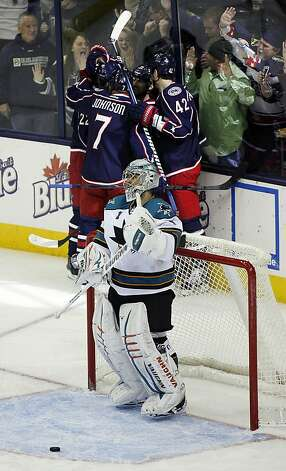 San Jose Sharks goalie Thomas Greiss (1) suffers another goal by the Columbus Blue Jackets during the third period of an NHL hockey game, Monday, Feb. 11, 2013, in Columbus, Ohio. This one was scored by Vinny Prospal, of the Czech Republic. Columbus won 6-2. (AP Photo/Mike Munden) Photo: Mike Munden, Associated Press