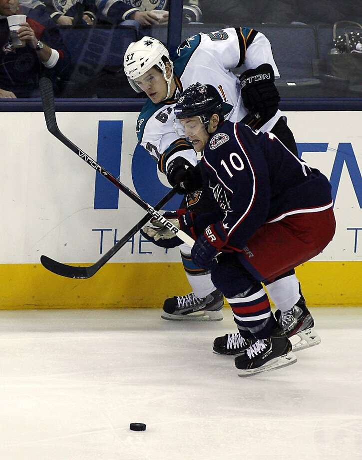 Columbus Blue Jackets' Mark Letestu (10) and San Jose Sharks' Tommy Wingels (57) battles on the boards during the third period of an NHL hockey game, Monday, Feb. 11, 2013, in Columbus, Ohio. (AP Photo/Mike Munden) Photo: Mike Munden, Associated Press