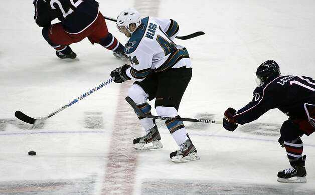 Columbus Blue Jackets' Marl Letestu, right, chases down San Jose Sharks' Marc-Edouard Vlasic (44) during the third period of an NHL hockey game, Monday, Feb. 11, 2013, in Columbus, Ohio. Columbus won 6-2. (AP Photo/Mike Munden) Photo: Mike Munden, Associated Press