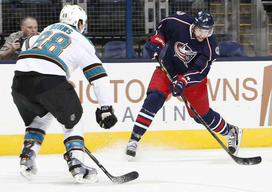Columbus Blue Jackets center Colton Gillies (9) fires a shot past San Jose Sharks defenseman Brent Burns (88) during the first period at Nationwide Arena in Columbus, Ohio, Monday, February 11, 2013. (Adam Cairns/Columbus Dispatch/MCT) Photo: Adam Cairns, McClatchy-Tribune News Service