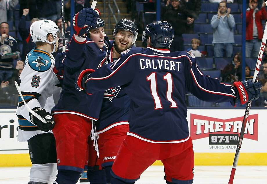 Columbus Blue Jackets left wing Matt Calvert (11) and left wing Nick Foligno (71) congratulate teammate center Brandon Dubinsky (17) on his first-period goal at Nationwide Arena in Columbus, Ohio, Monday, February 11, 2013. (Adam Cairns/Columbus Dispatch/MCT) Photo: Adam Cairns, McClatchy-Tribune News Service