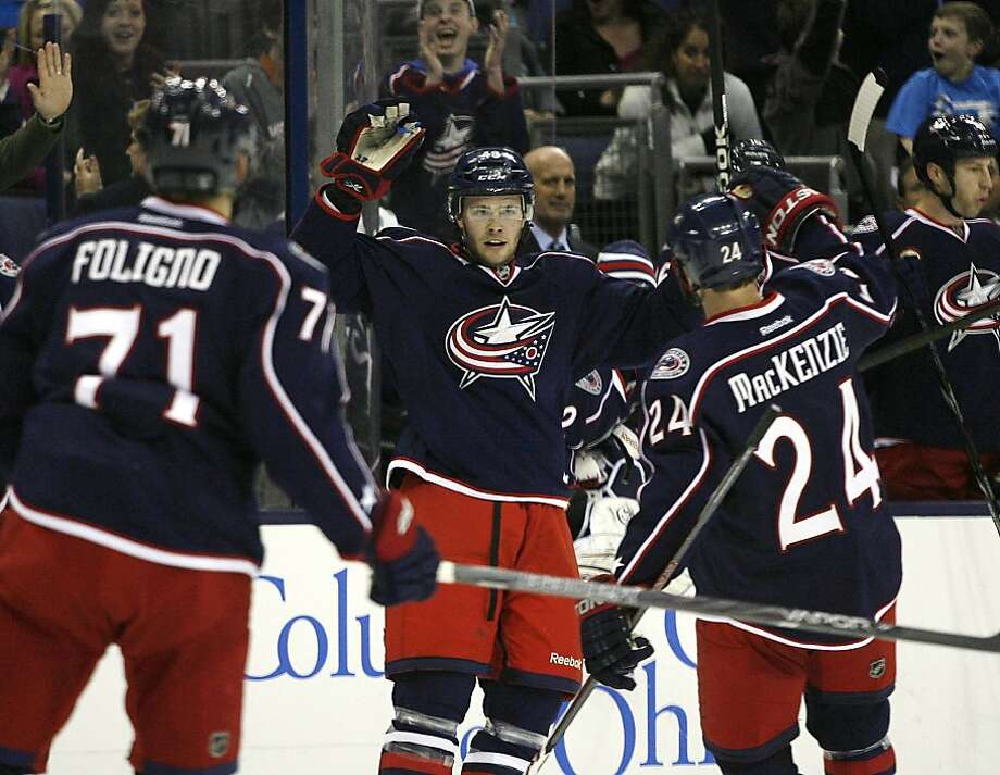 Columbus Blue Jackets' Cody Goloubef (48) celebrates his first NHL goal against the San Jose Sharks during the second period of an NHL hockey game, Monday, Feb. 11, 2013, in Columbus, Ohio. (AP Photo/Mike Munden) Photo: Mike Munden, Associated Press