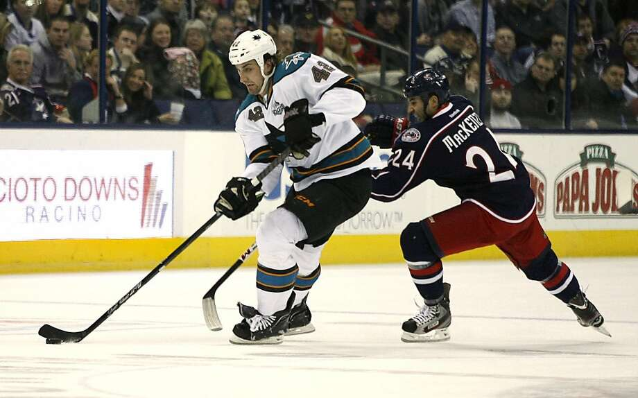 San Jose Sharks' Matt Pelech (42) races past Columbus Blue Jackets' Derek MacKenzie during the first period of an NHL hockey game, Monday, Feb. 11, 2013, in Columbus, Ohio. (AP Photo/Mike Munden) Photo: Mike Munden, Associated Press