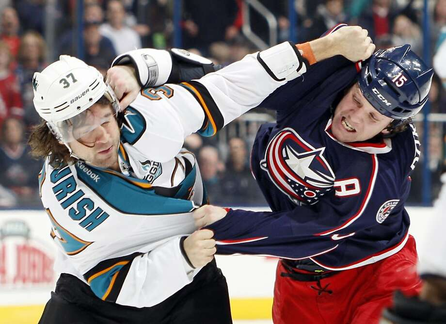 Columbus Blue Jackets right wing Derek Dorsett (15) tussles with San Jose Sharks right wing Adam Burish (37) during the first period at Nationwide Arena in Columbus, Ohio, Monday, February 11, 2013. (Adam Cairns/Columbus Dispatch/MCT) Photo: Adam Cairns, McClatchy-Tribune News Service