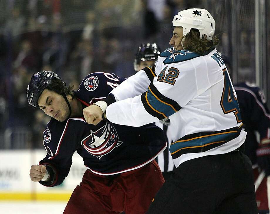 Columbus Blue Jackets' Jared Boll, left, and San Jose Sharks' Matt Pelech (42) fight during the first period of an NHL hockey game, Monday, Feb. 11, 2013, in Columbus, Ohio. Boll set a team record of 120 fights. (AP Photo/Mike Munden) Photo: Mike Munden, Associated Press