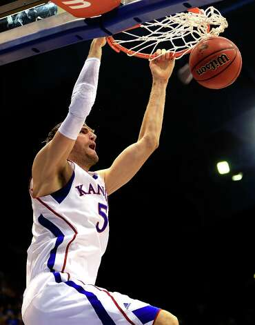 Not — Kansas C Jeff Withey: Committed 11 turnovers against seven blocks in his last three games. Photo: Jamie Squire, Getty Images / 2013 Getty Images