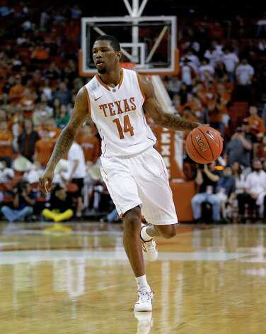 Not — Texas G Julien Lewis: Struggling through a 31.7 percent stretch from the field in his last six games. Photo: Eric Gay, Associated Press / AP