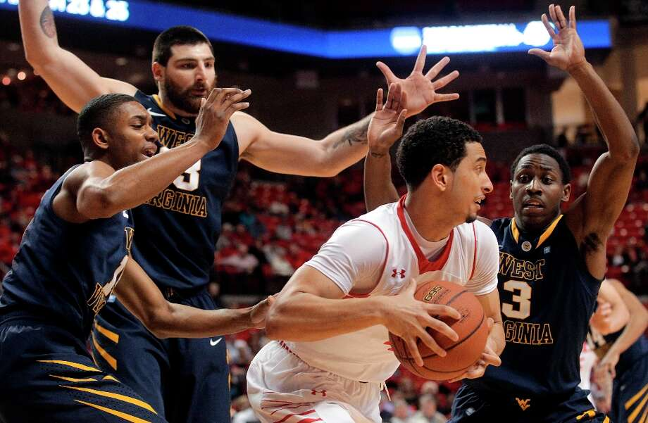 Not — Texas Tech's sputtering offense: The Red Raiders have not scored more than 63 points in any Big 12 game this season. Tech is hitting 35.8 percent from the field and 26.9 percent from 3-point territory in their last two games. Photo: Stephen Spillman, Associated Press / Lubbock Avalanche-Journal