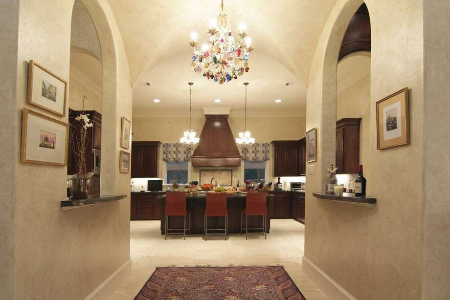 The groin vaulted ceiling separates the kitchen from the family room. With the walk-in wine and wet bar on either side Photo: Martha Turner Properties