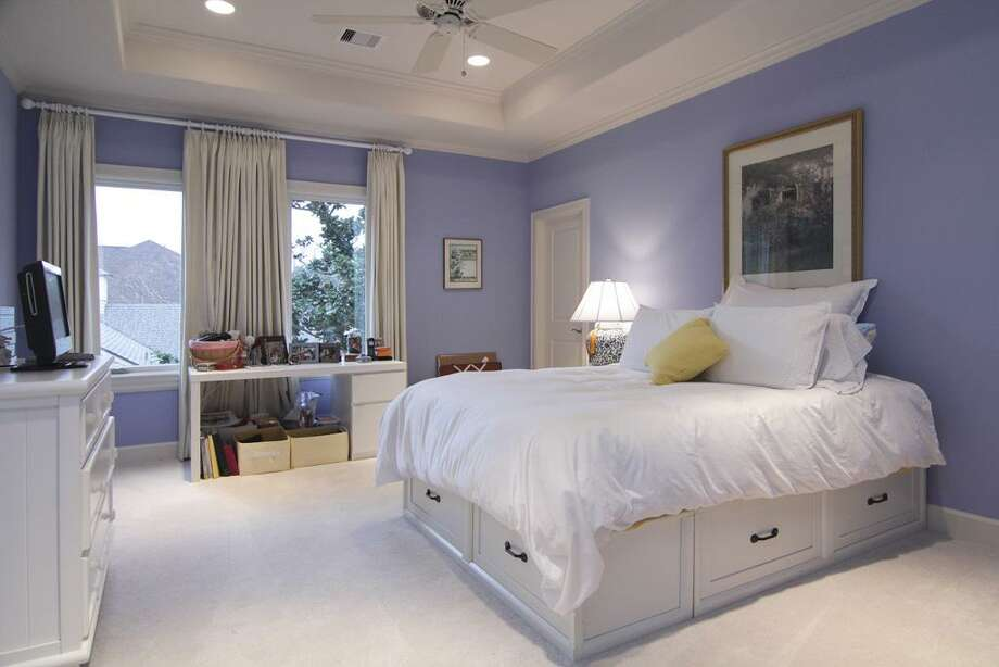 The secondary bedroom with large walk-in closet and private bathroom. Note how much furniture this room can accommodate. Photo: Martha Turner Properties