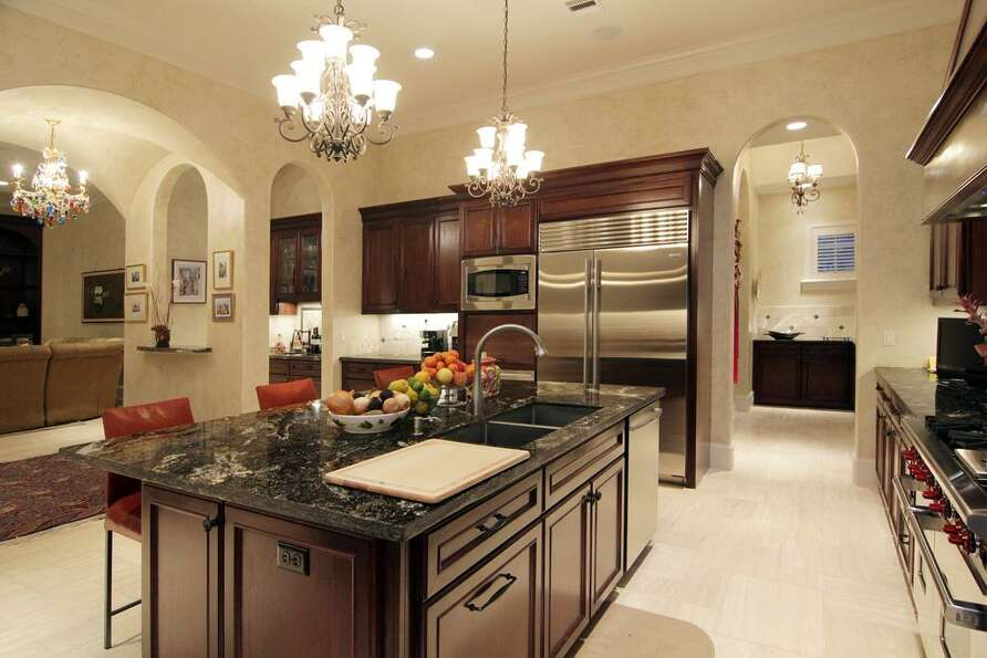 Dream kitchen w/ top of the line S.S. appliances. Large granite island is perfect to gather around.