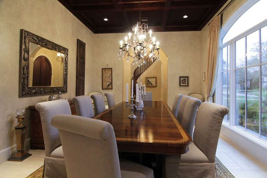 Simply stunning this large yet comfortable dining room w/ mahogany boxed ceiling is perfect for entertaining. Recessed speakers, plastered walls all create that special ambiance. Photo: Martha Turner Properties