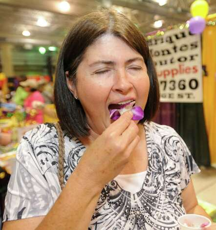 Debbie Mahana was brave enough to try Orchid Petals from Enrique Montes Distributors.  She said it tasted like grass. The annual Taste of the Triangle was held at the Ford Exhibit Hall at Ford Park.  It  featured food booths from all over the area, from country and soul foods, to Tai, Italian, Cajun and Creole foods. This was the 29th annual event put on by the Sabine Area Restaurant Association.    Dave Ryan/The Enterprise