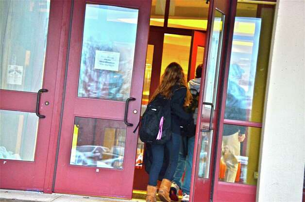 New Canaan Public Schools reopened this morning after a four-day weekend thanks to the blizzard. Above, students file into the high school. Photo by Jeanna Petersen Shepard  Feb. 12, 2013 Photo: Freelance Photo
