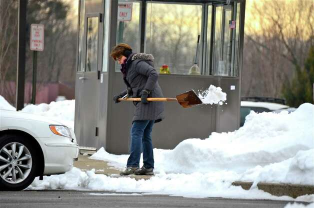 New Canaan Public Schools reopened this morning after a four-day weekend thanks to the blizzard. Above, Helen Casinelli, NCHS parking attendant, shovels the walkway. Photo by Jeanna Petersen Shepard  Feb. 12, 2013 Photo: Freelance Photo