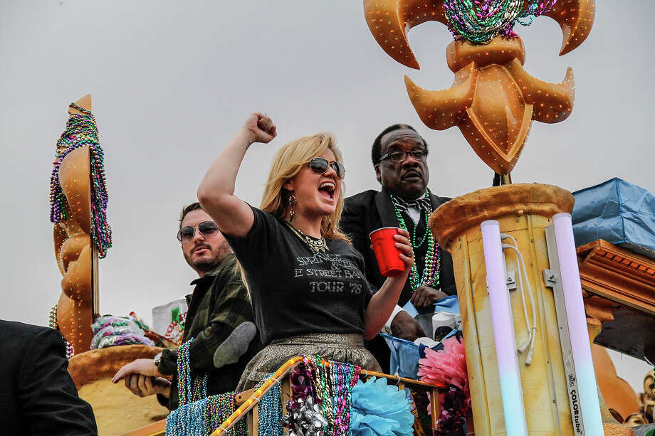 Reigning celebrity grand marshal (R) Kelly Clarkson with her fiance (L) Brandon Blackstock while riding in the 2013 Krewe Of Endymion Mardi Gras Parade on February 9, 2013 in New Orleans, Louisiana. Photo: Skip Bolen, Getty Images / 2013 Skip Bolen