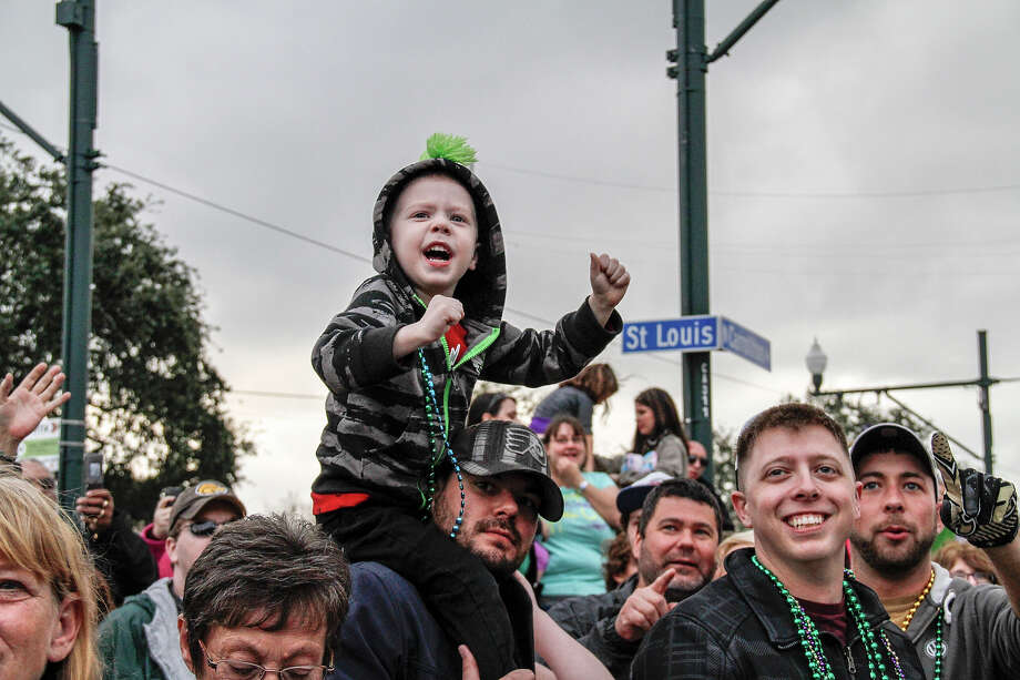 Fans and revelers attend the 2013 Krewe Of Endymion Mardi Gras Parade to catch beads and doubloons on February 9, 2013 in New Orleans, Louisiana. Photo: Skip Bolen, Getty Images / 2013 Skip Bolen
