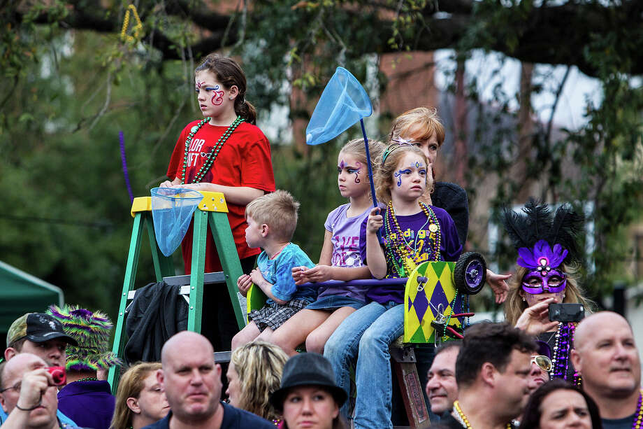 Young fans waiting to catch Mardi Gras beads, cups and doubloons as the 2013 Krewe of Bacchus Mardi Gras Parade passes by on February 10, 2013 in New Orleans, Louisiana. Photo: Skip Bolen, Getty Images / 2013 Skip Bolen