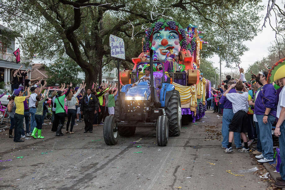 Float riders toss beads, cups and doubloons to fans and revelers in the 2013 Krewe of Bacchus Mardi Gras Parade on February 10, 2013 in New Orleans, Louisiana. Photo: Skip Bolen, Getty Images / 2013 Skip Bolen