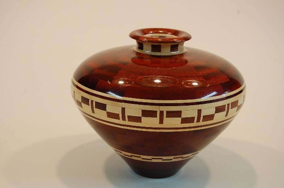 "Honorable mention: ""Bloodwood and Holly Vessel"" by Raymond Puffer of Watervliet, sculpture (wood turning) (Albany Center Gallery)"
