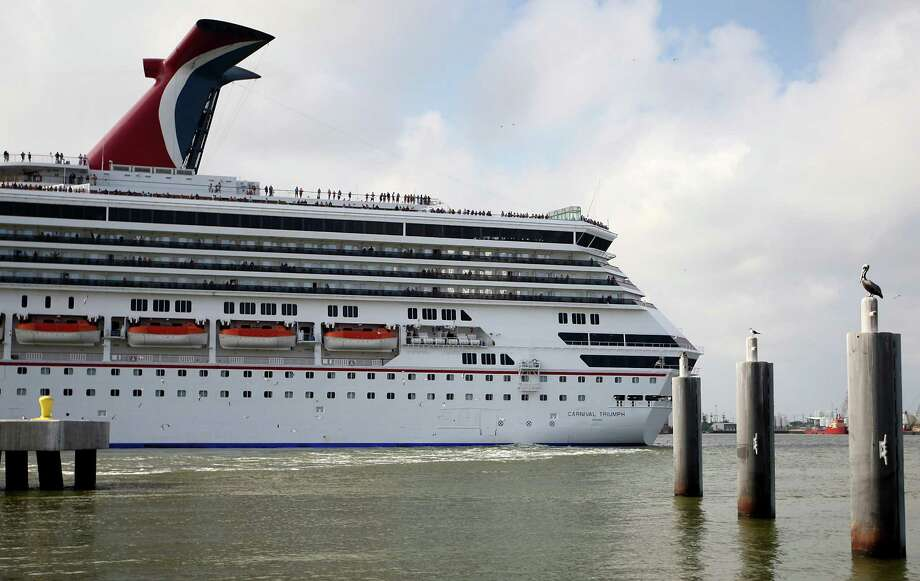 The Carnival cruise ship Triumph leaves port shortly before 5pm Saturday, March 31, 2012, in Galveston, after a temporary legal grounding. Photo: Karen Warren, Houston Chronicle / © 2012  Houston Chronicle