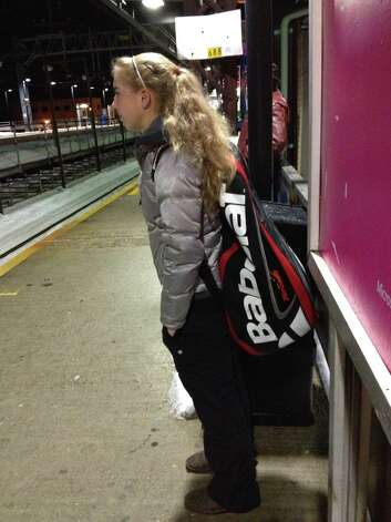 Fairfield native Ellyse Hamlin waits for the 6:07 a.m. train at Fairfield Train Station on Tuesday. Hamlin takes the early train to Grand Central Terminal six days per week to train at the USTA training center in Queens. Photo: Contributed Photo