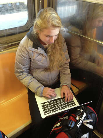 Fairfield native Ellyse Hamlin keeps busy doing work on the 6:07 a.m. train from Fairfield to Grand Central Terminal in New York on Tuesday. Photo: Contributed Photo
