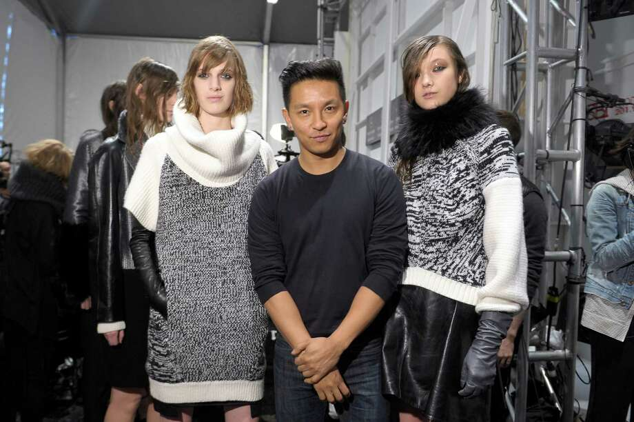 NEW YORK, NY - FEBRUARY 11:  Designer Prabal Gurung (center) and models pose backstage at the ICB By Prabal Gurung Fall 2013 fashion show during Mercedes-Benz Fashion Week at The Studio at Lincoln Center on February 11, 2013 in New York City.  (Photo by Michael Loccisano/Getty Images for Mercedes-Benz Fashion Week) Photo: Michael Loccisano, Staff / 2013 Getty Images